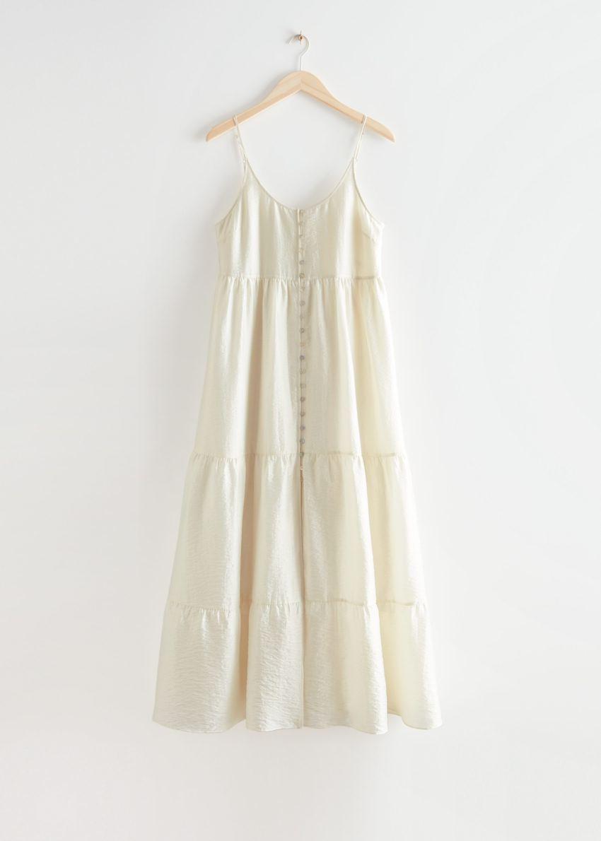 앤아더스토리즈 스트래피 버튼 맥시 드레스의 화이트컬러 Product입니다.