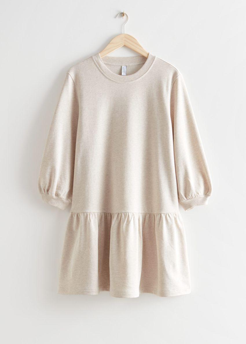 앤아더스토리즈 티어드 저지 미니 드레스의 베이지컬러 Product입니다.