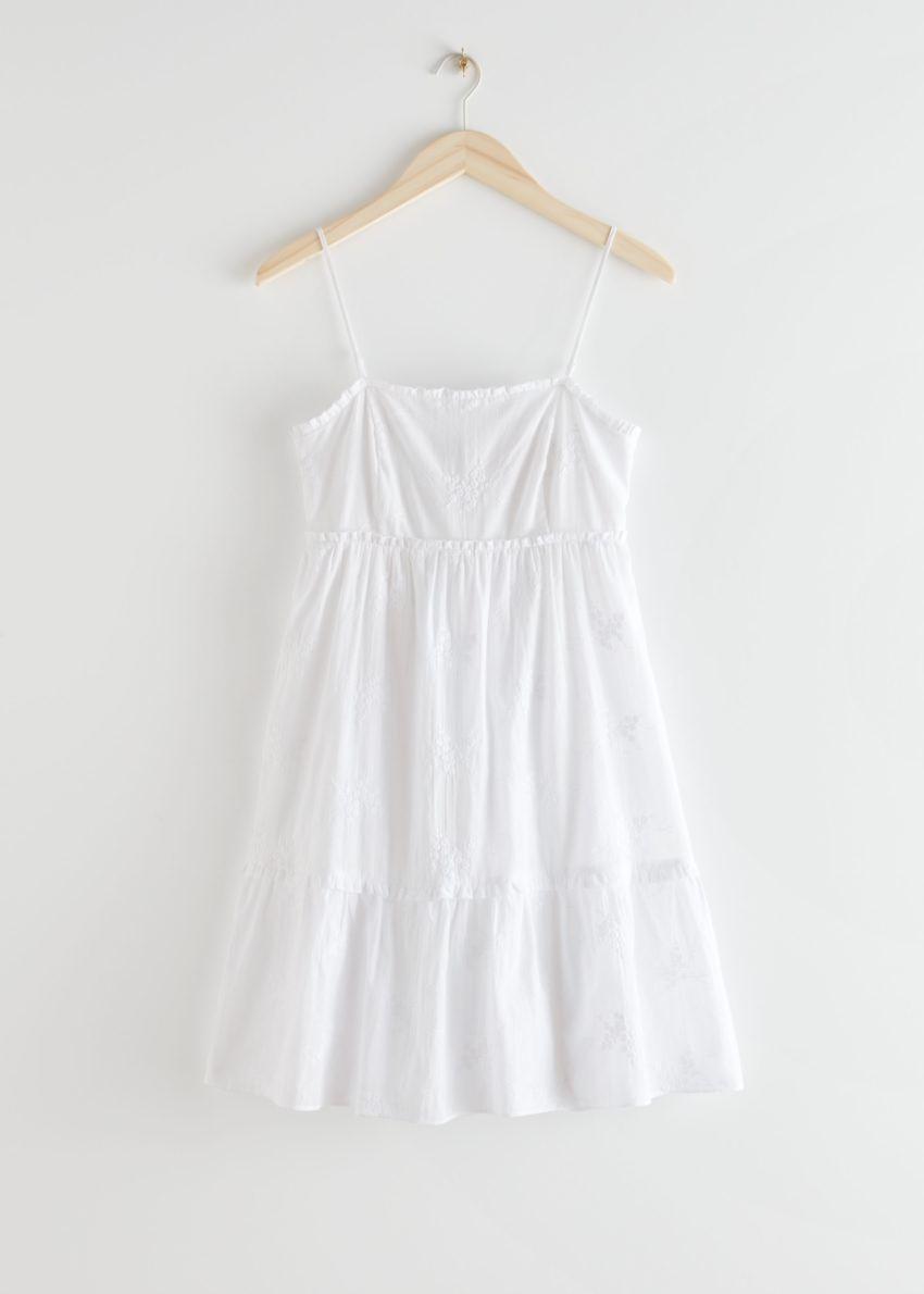 앤아더스토리즈 프릴 스파게티 스트랩 미니 드레스의 화이트컬러 Product입니다.