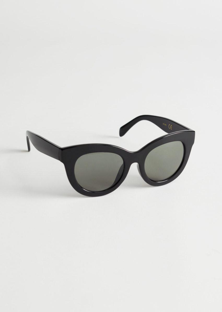 앤아더스토리즈 오버사이즈 라운드 선글라스의 블랙컬러 Product입니다.