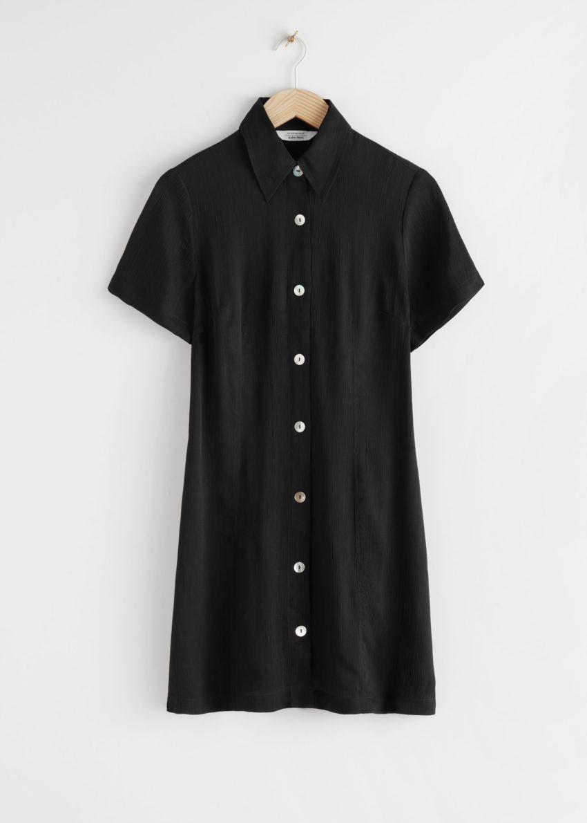 앤아더스토리즈 버튼 업 미니 드레스의 블랙컬러 Product입니다.