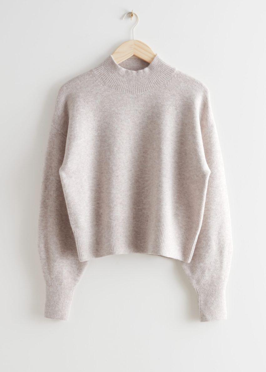 앤아더스토리즈 모크 넥 스웨터의 베이지 멜란지컬러 Product입니다.