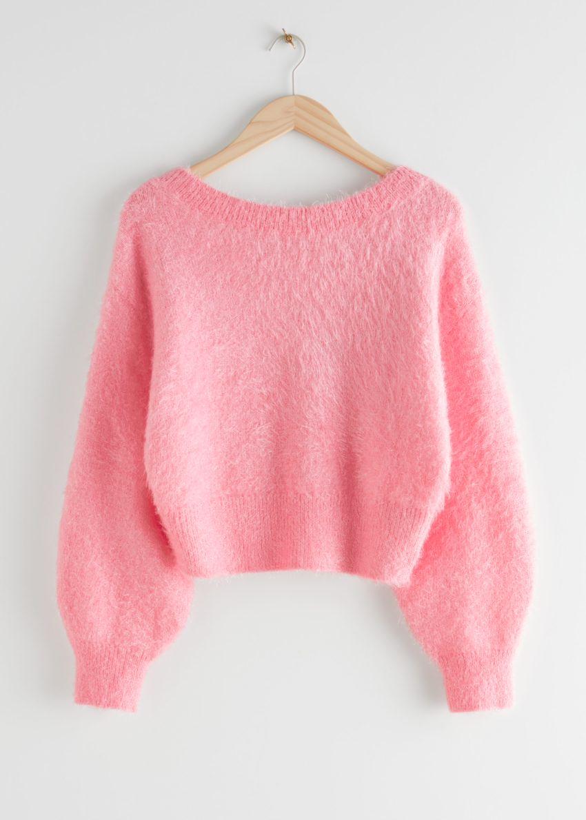 앤아더스토리즈 릴렉스드 퍼지 브이컷 백 스웨터의 핑크컬러 Product입니다.