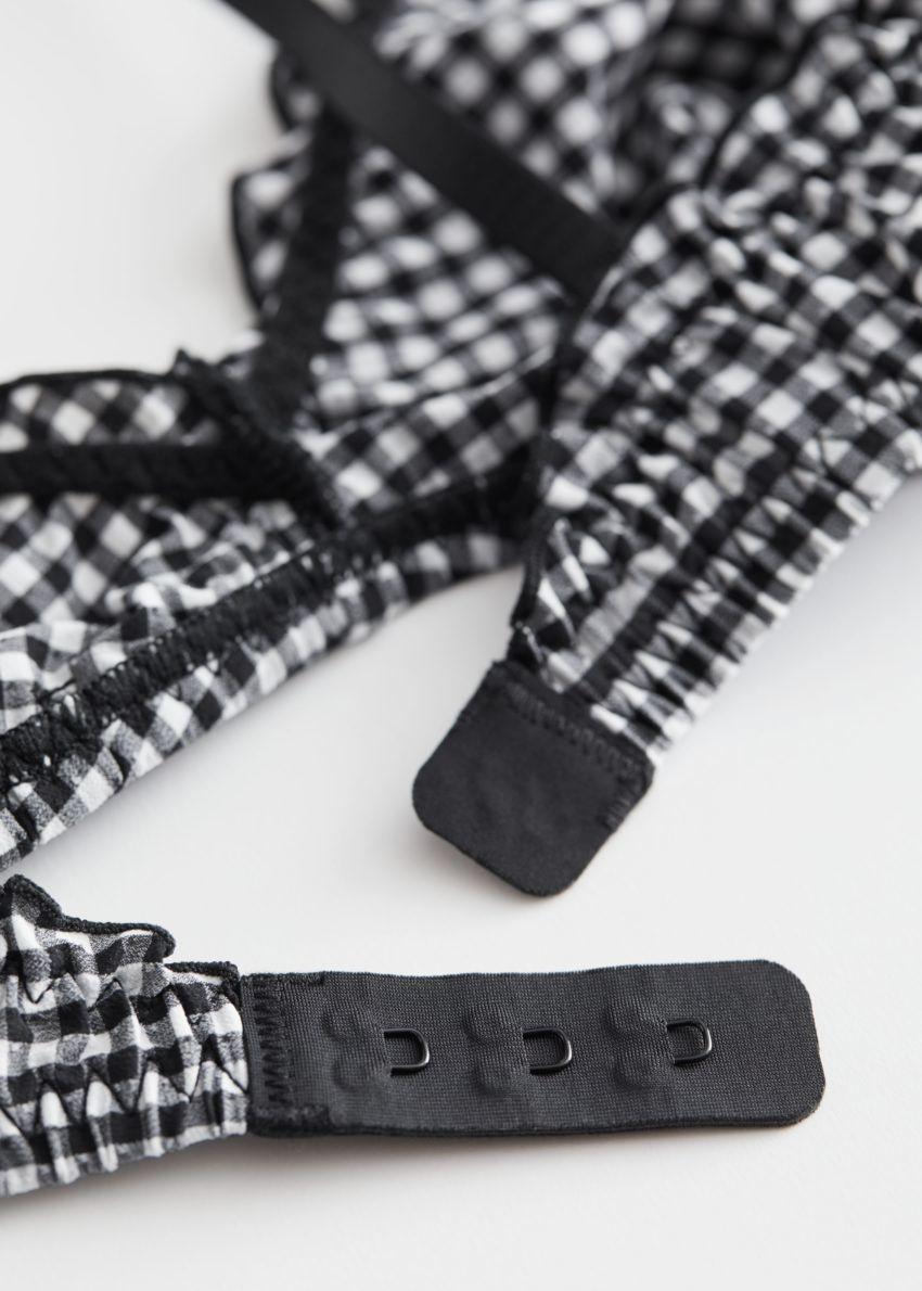 앤아더스토리즈 텍스처 러플 트림 소프트 브라의 블랙 깅엄컬러 Product입니다.