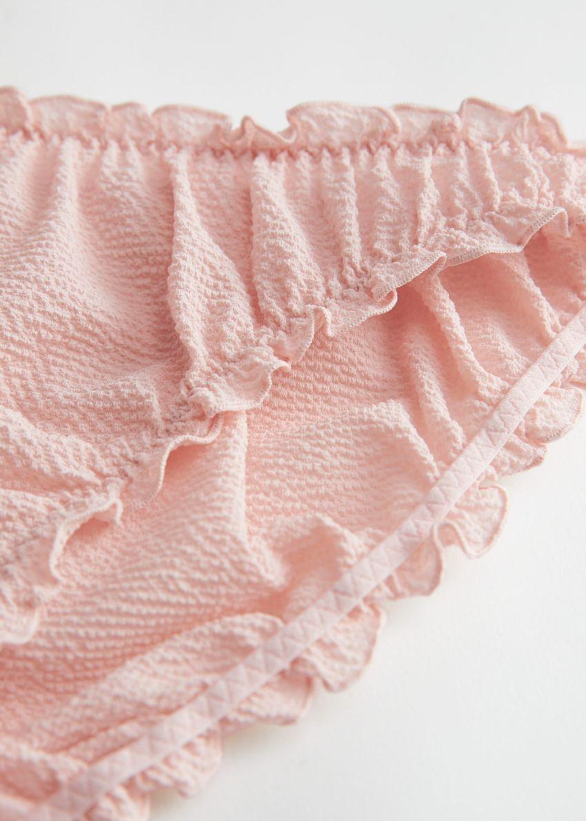 앤아더스토리즈 러플 트림 개더드 브리프의 라이트 핑크컬러 Detail입니다.