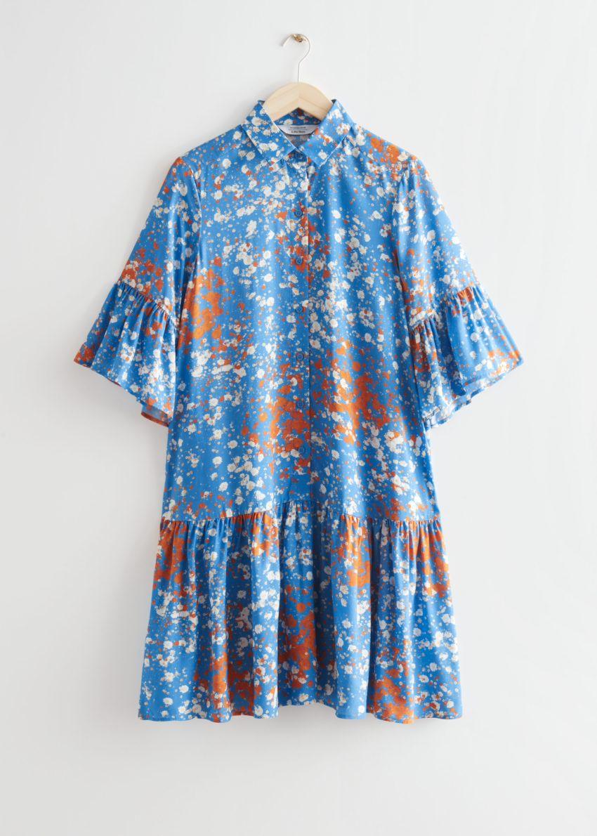 앤아더스토리즈 버튼 러플 미디 드레스의 블루 플로럴컬러 Product입니다.