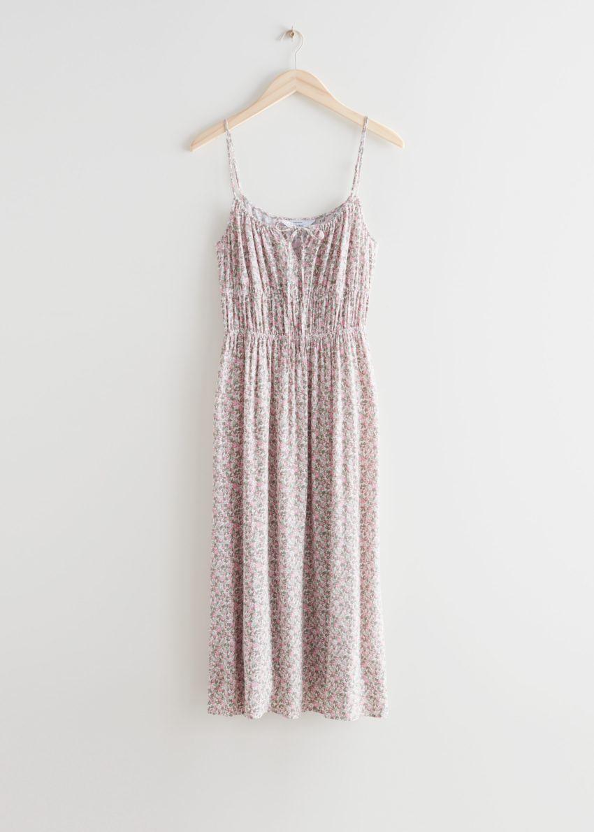 앤아더스토리즈 스트래피 미디 드레스의 핑크 프린트컬러 Product입니다.