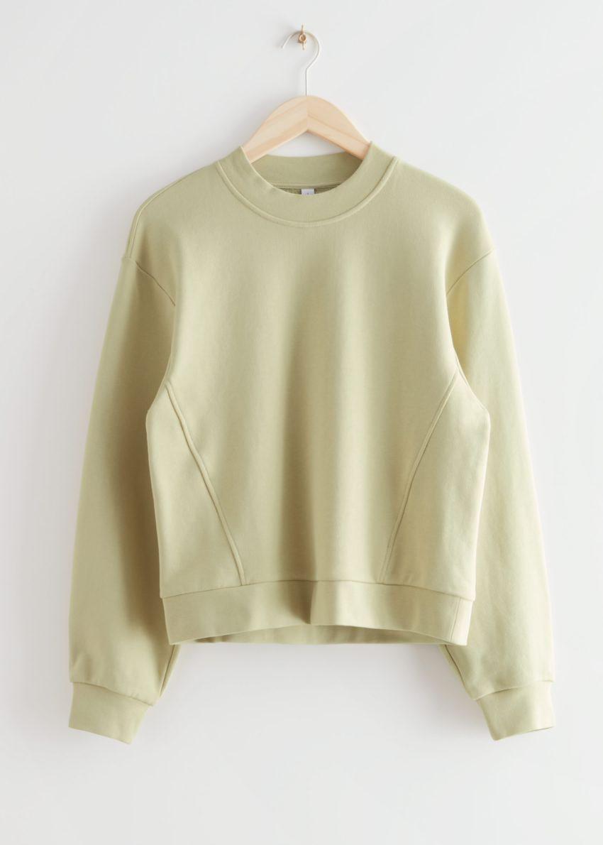 앤아더스토리즈 릴렉스드 바나나 슬리브 스웨터의 옐로우컬러 Product입니다.