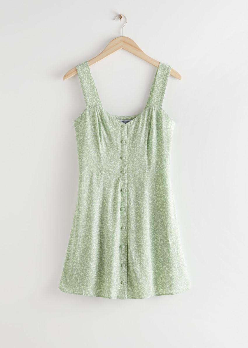 앤아더스토리즈 슬리브리스 버튼 업 미니 드레스의 그린 프린트컬러 Product입니다.