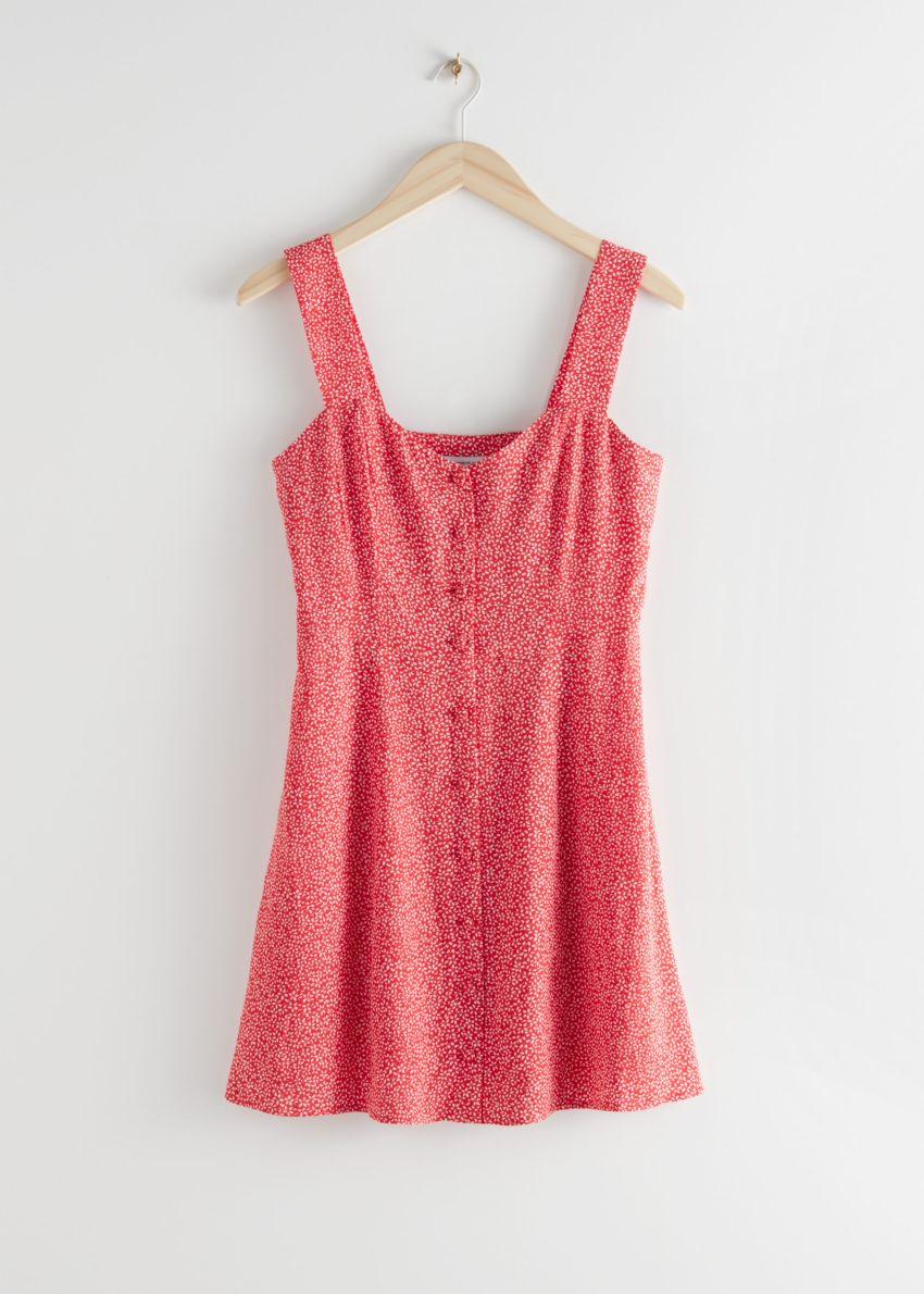 앤아더스토리즈 슬리브리스 버튼 업 미니 드레스의 레드 프린트컬러 Product입니다.