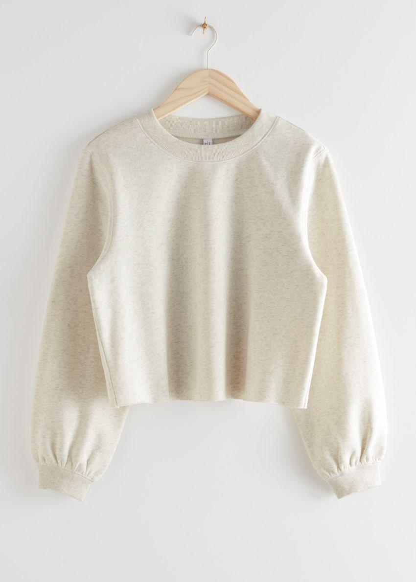 앤아더스토리즈 박시 저지 스웨터의 화이트 멜란지컬러 Product입니다.