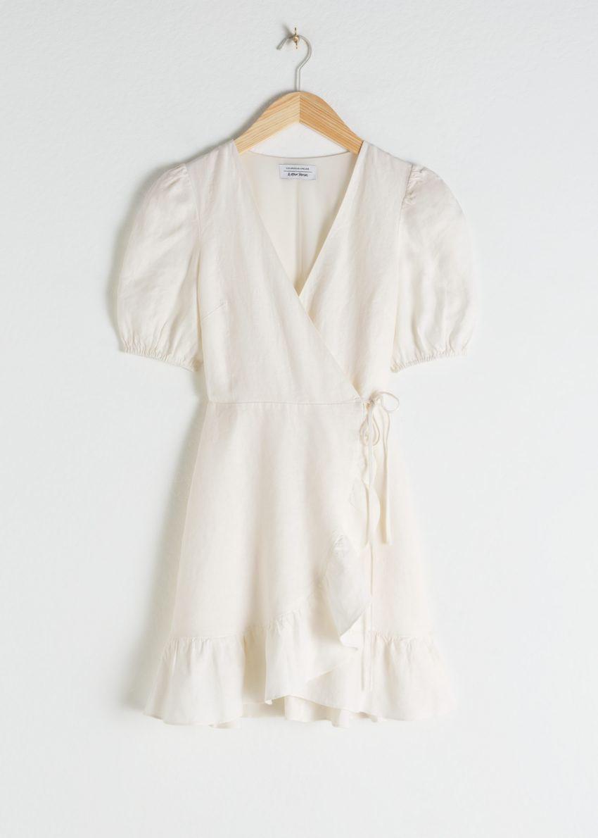 앤아더스토리즈 퍼프 슬리브 리넨 랩 미니 드레스의 화이트컬러 Product입니다.