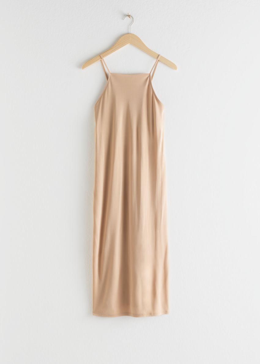 앤아더스토리즈 스퀘어 넥 미디 슬립 드레스의 베이지컬러 Product입니다.