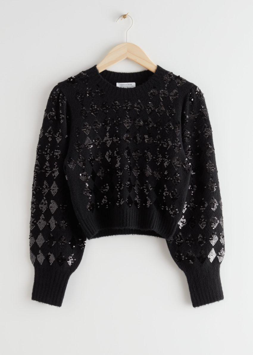 앤아더스토리즈 스파클링 할리퀸 퍼프 슬리브 스웨터의 블랙 할리퀸컬러 Product입니다.