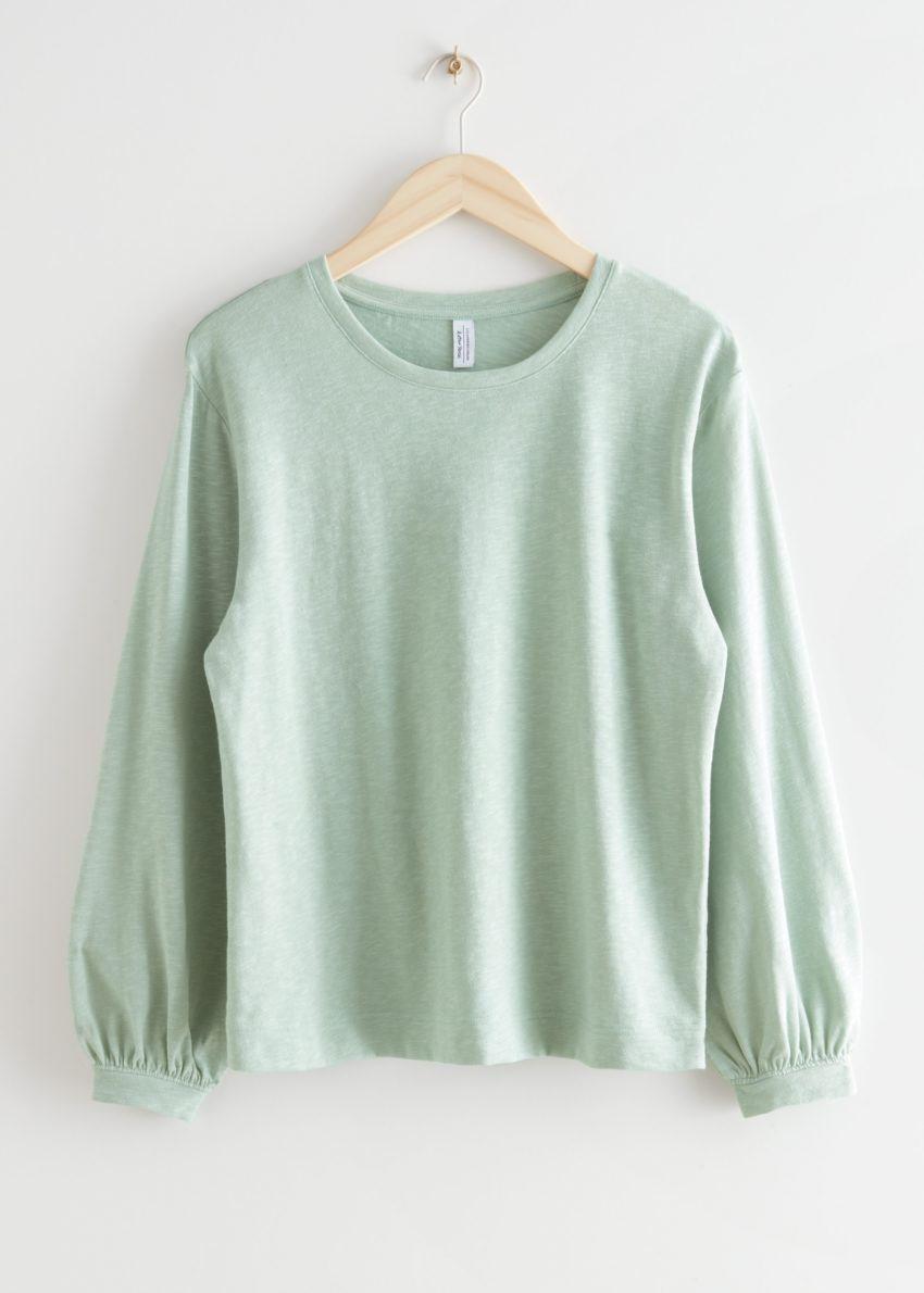 앤아더스토리즈 릴렉스드 롱 슬리브 티셔츠의 라이트 그린컬러 Product입니다.
