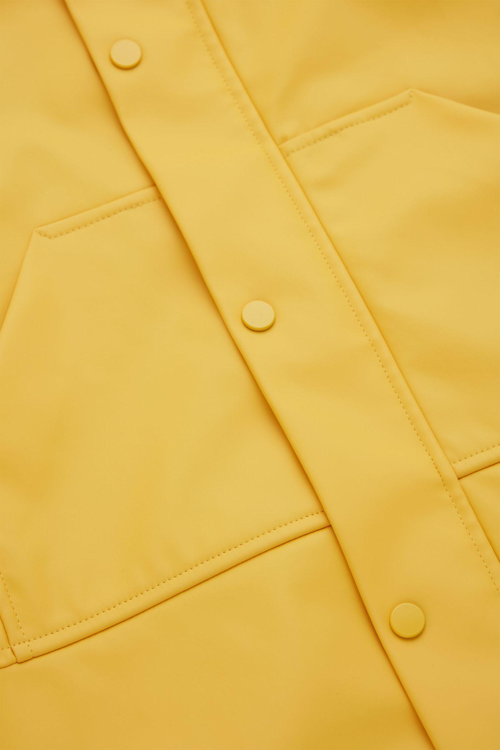 COS 패널드 레인코트의 옐로우컬러 Detail입니다.