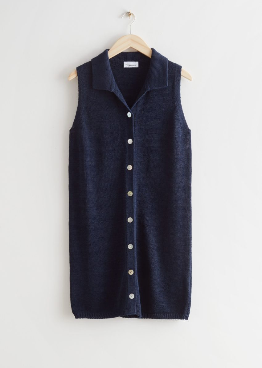 앤아더스토리즈 슬리브리스 펄 버튼 미니 드레스의 네이비컬러 Product입니다.