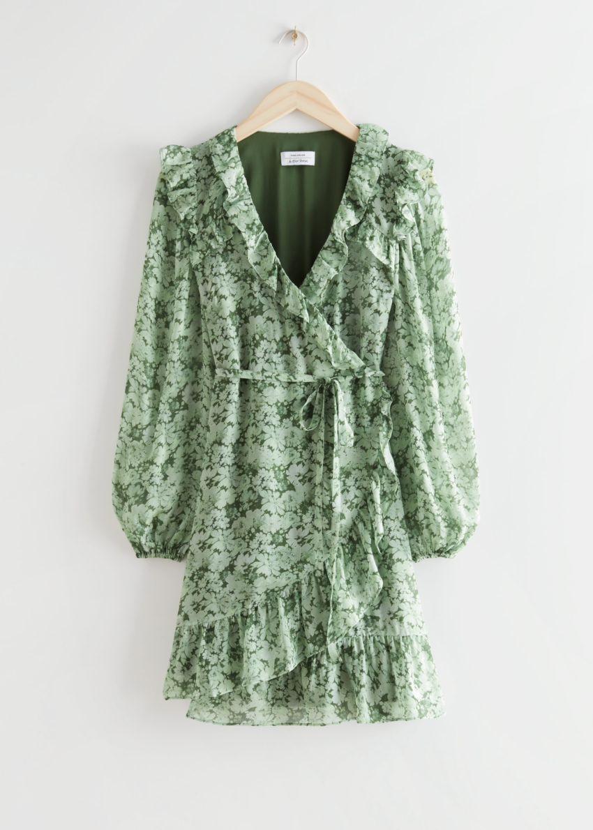 앤아더스토리즈 러플 미니 랩 드레스의 그린 프린트컬러 Product입니다.