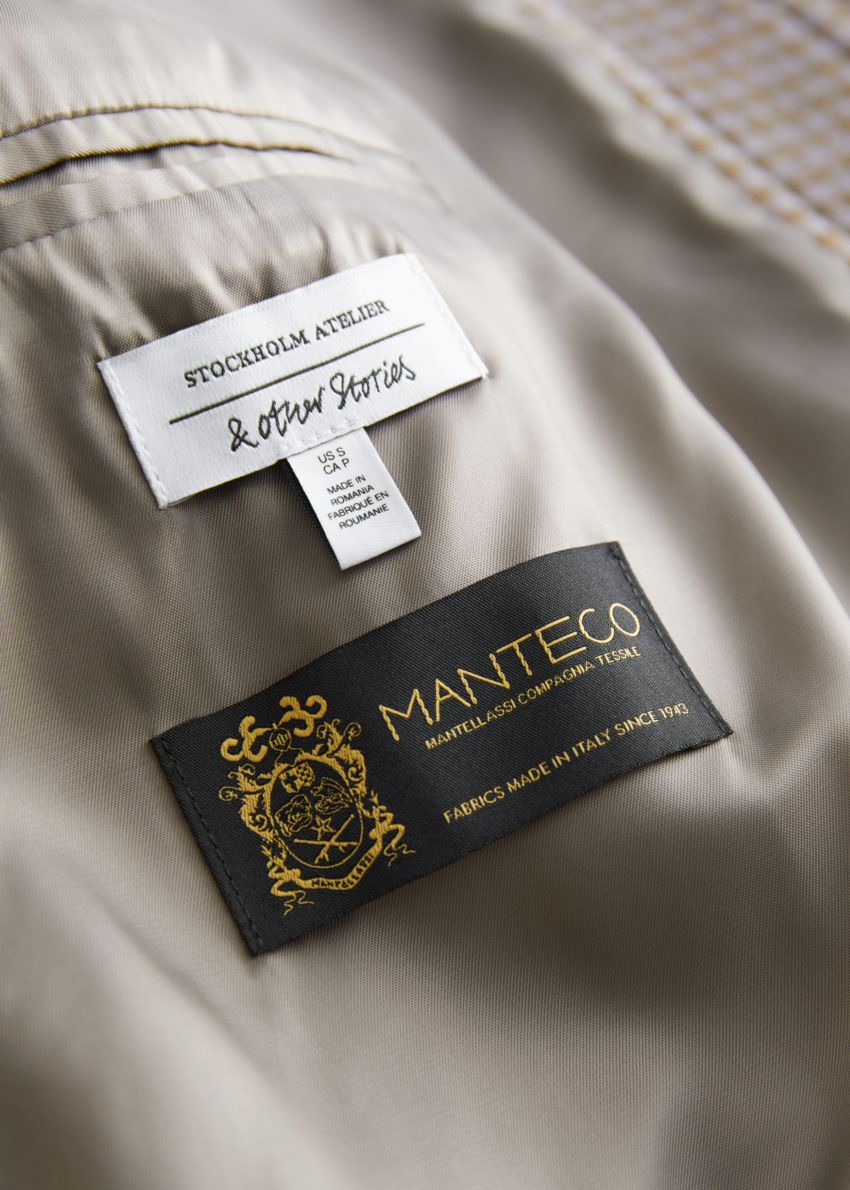 앤아더스토리즈 오버사이즈 셔츠 재킷의 카키 체크컬러 Detail입니다.
