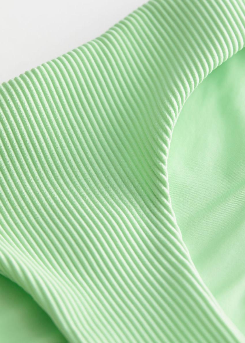 앤아더스토리즈 립 비키니 핫팬츠의 라이트 그린컬러 Detail입니다.