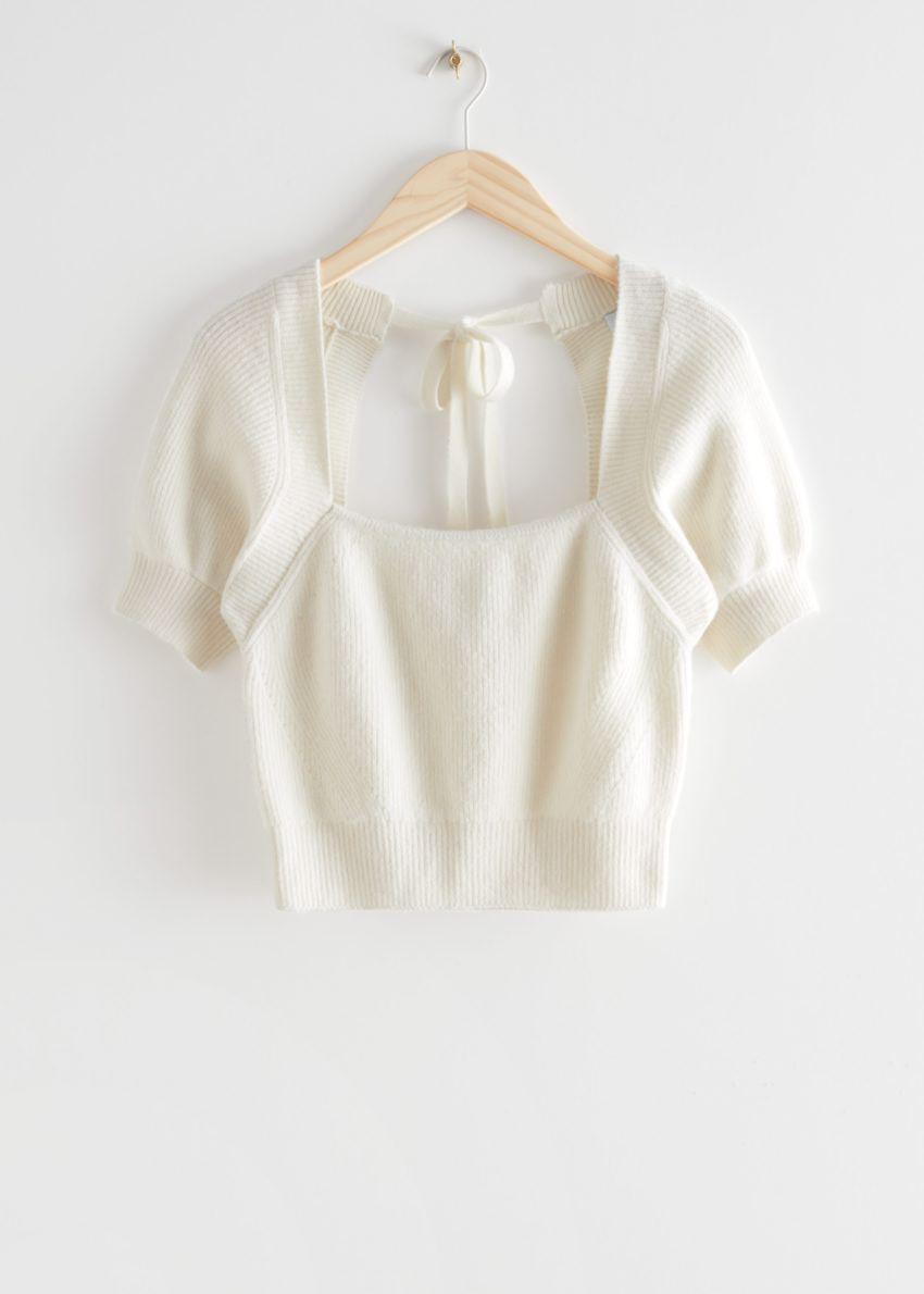 앤아더스토리즈 넥 타이 니트 스웨터의 화이트컬러 Product입니다.