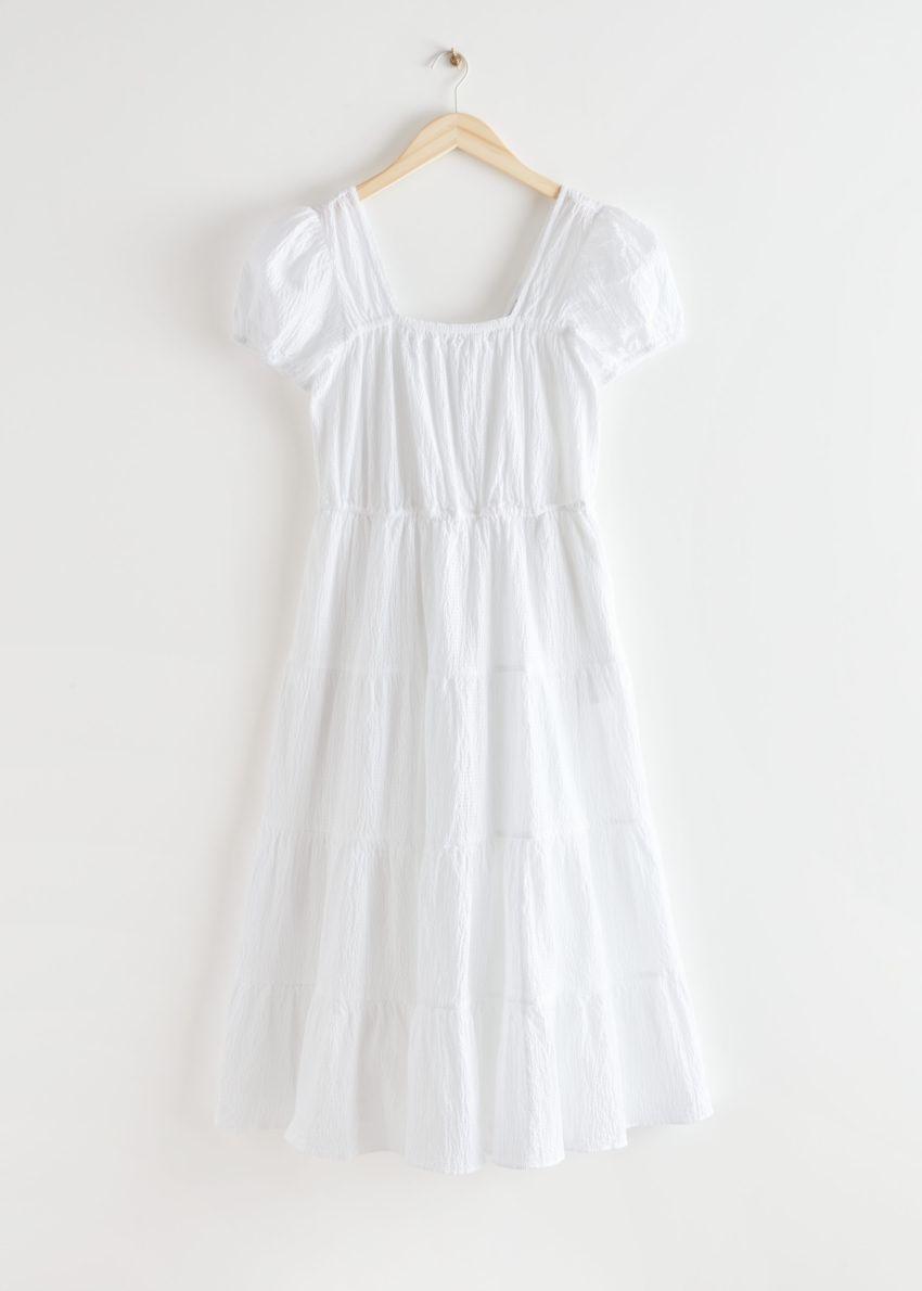 앤아더스토리즈 볼류미너스 퍼프 슬리브 미디 드레스의 화이트컬러 Product입니다.