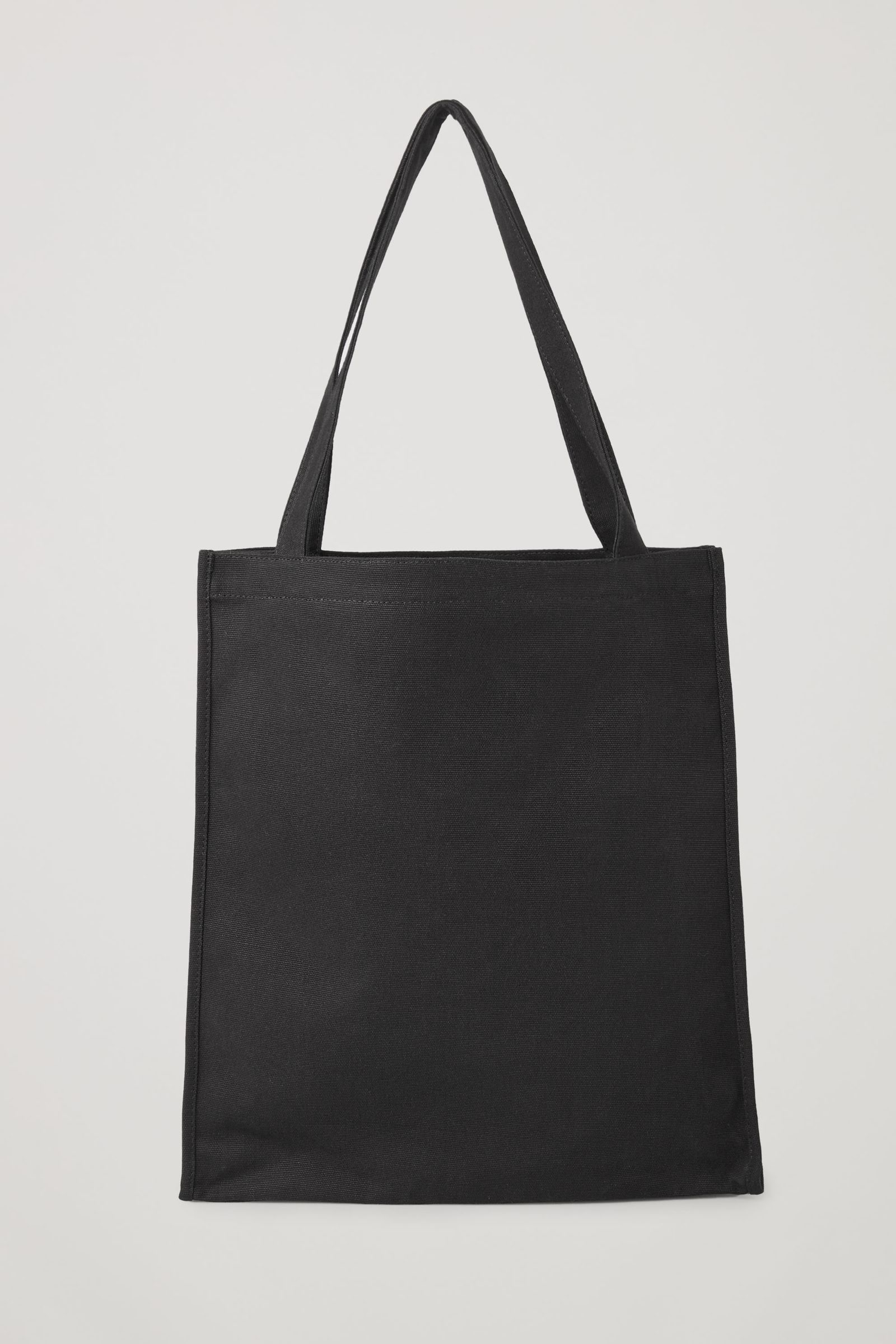 COS 포토 프린트 캔버스 토트백의 블랙 / 베이지컬러 Product입니다.
