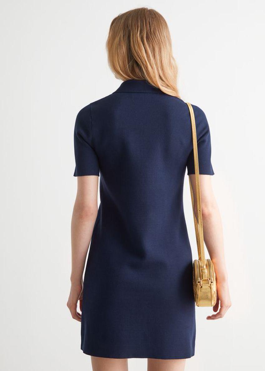 앤아더스토리즈 미니 폴로 드레스의 네이비컬러 ECOMLook입니다.