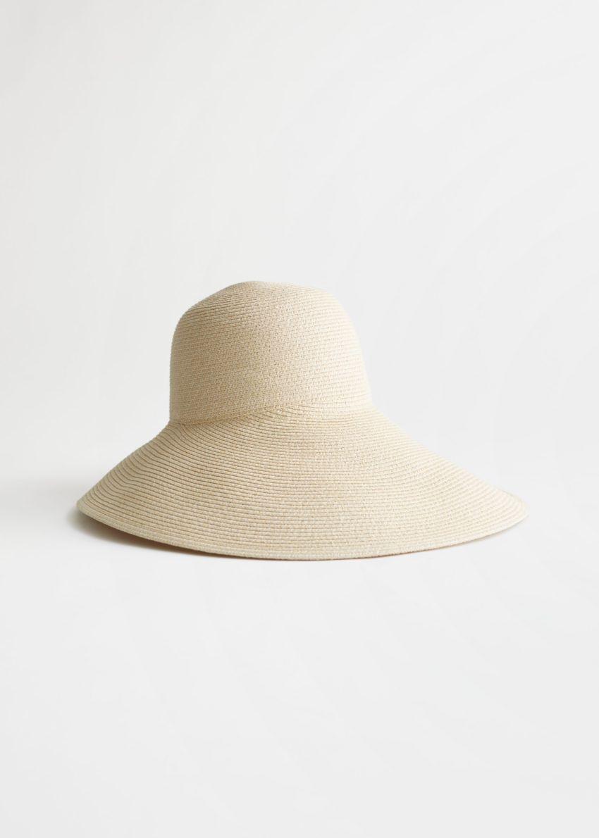 앤아더스토리즈 와이드 브림 스트로 리본 햇의 화이트컬러 Product입니다.