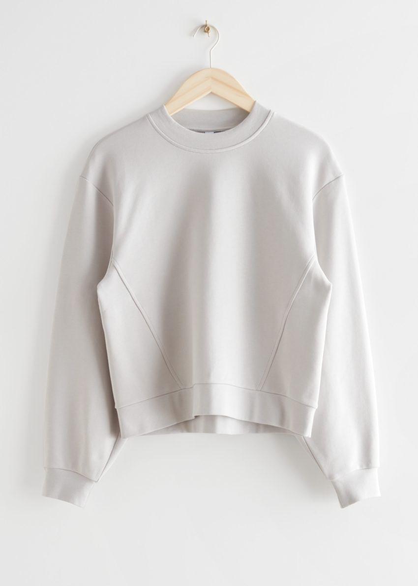 앤아더스토리즈 릴렉스드 바나나 슬리브 스웨터의 라이트 그레이컬러 Product입니다.