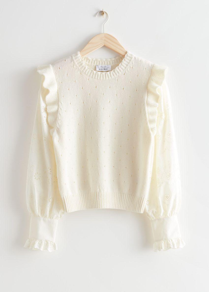 앤아더스토리즈 니트 러플 엠브로이더리 스웨터의 화이트컬러 Product입니다.
