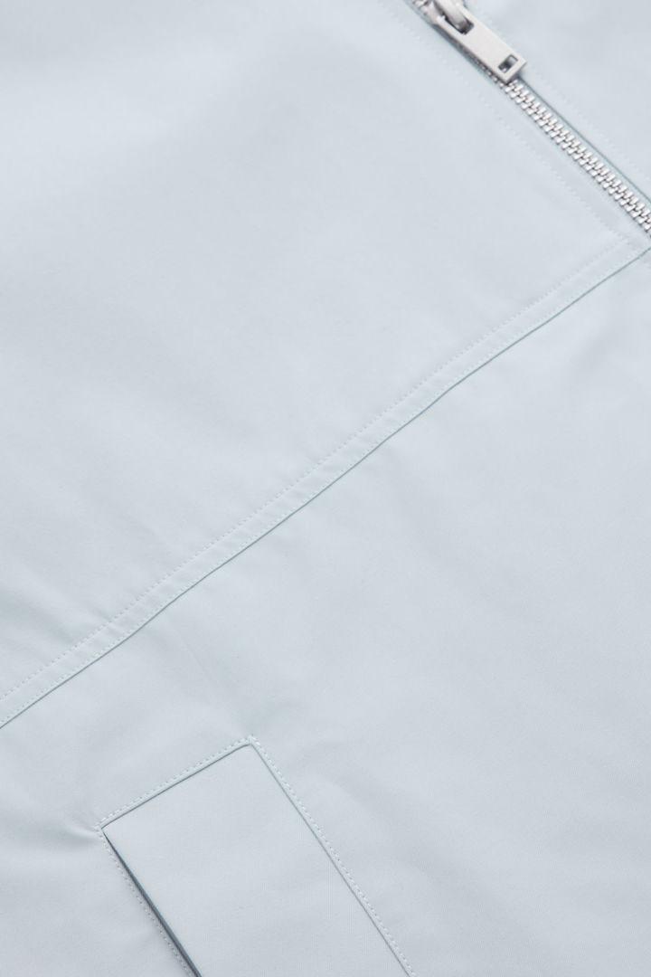 COS 커브드 헴 후드 판초의 라이트 그레이컬러 Product입니다.