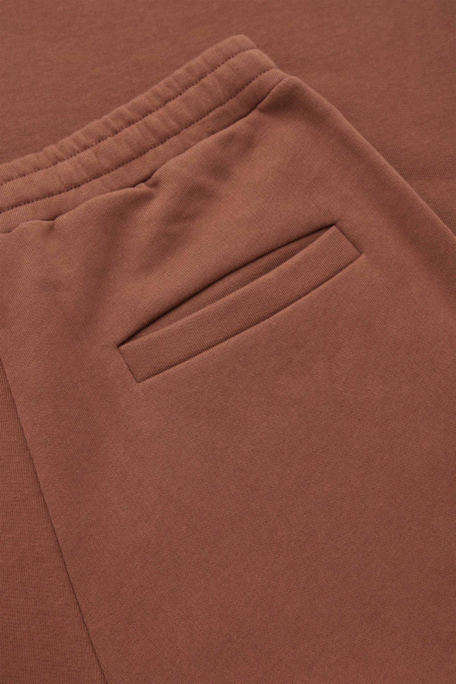 COS 레귤러 핏 와이드 레그 조거의 번트 오렌지컬러 Detail입니다.