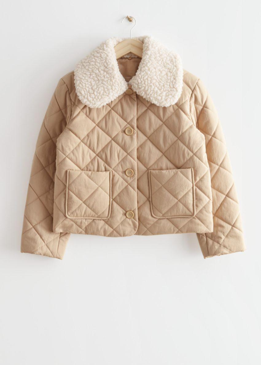 앤아더스토리즈 퀼티드 리무버블 카라 재킷의 베이지컬러 Product입니다.