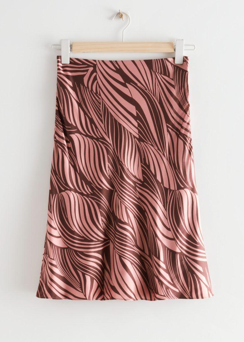 앤아더스토리즈 스월 프린트 미디 스커트의 핑크 프린트컬러 Product입니다.