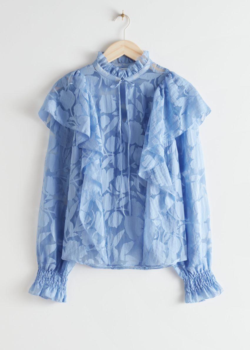 앤아더스토리즈 러플 오버레이 블라우스의 블루 플로럴컬러 Product입니다.