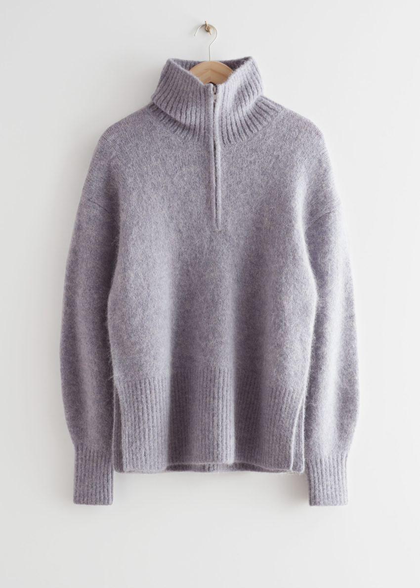 앤아더스토리즈 오버사이즈 하프-집 스웨터의 라일락컬러 Product입니다.