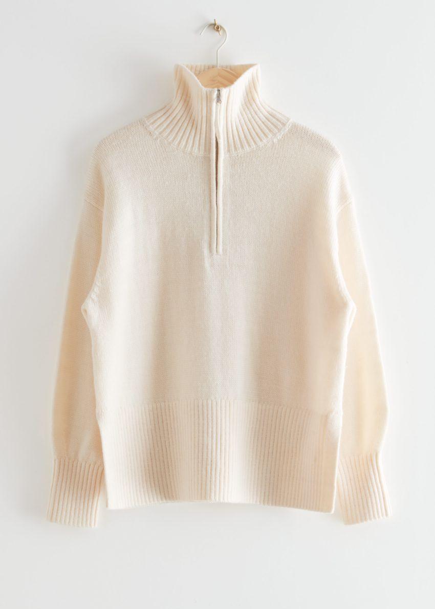 앤아더스토리즈 오버사이즈 하프-집 스웨터의 화이트컬러 Product입니다.