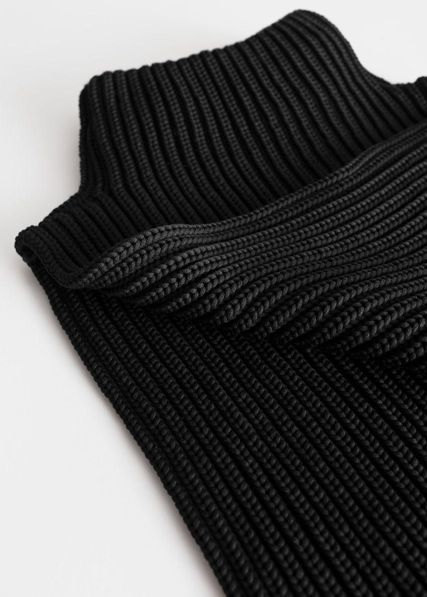 앤아더스토리즈 청키 립 니트 목 토시의 블랙컬러 Product입니다.
