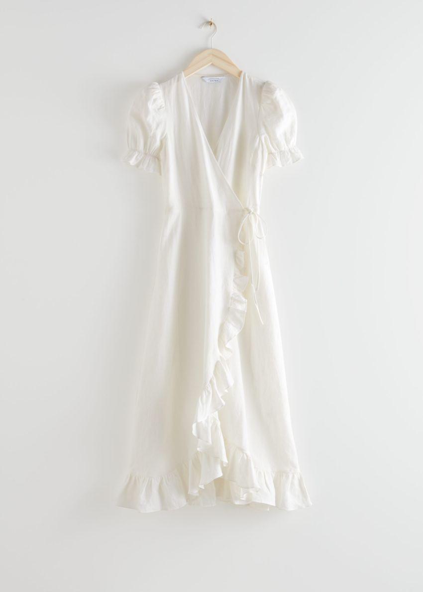 앤아더스토리즈 리넨 미디 랩 드레스의 화이트컬러 Product입니다.