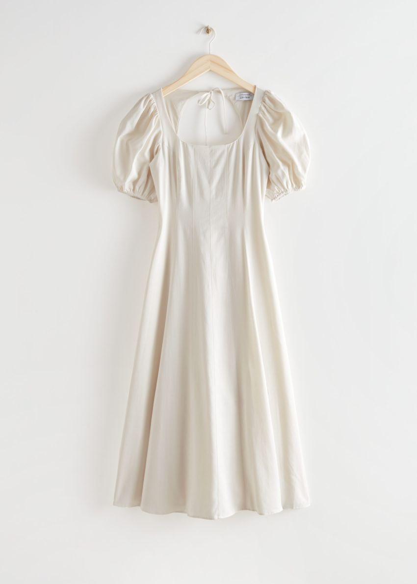 앤아더스토리즈 오픈 백 퍼프 슬리브 미디 드레스의 화이트컬러 Product입니다.