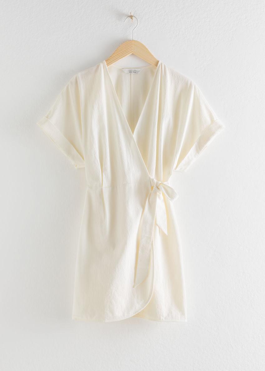 앤아더스토리즈 코튼 랩 미니 드레스의 크림컬러 Product입니다.