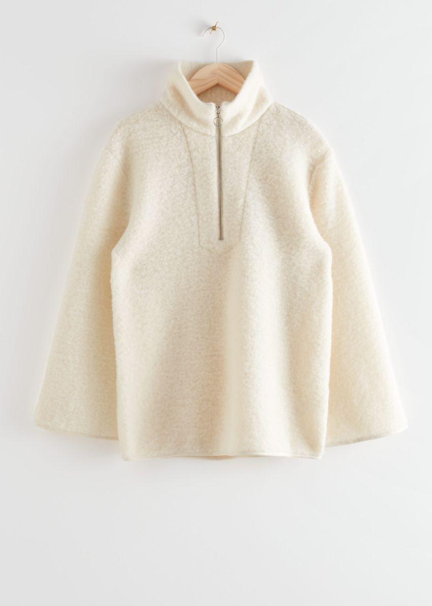 앤아더스토리즈 오버사이즈 집 카라 울 스웨터의 크림컬러 Product입니다.