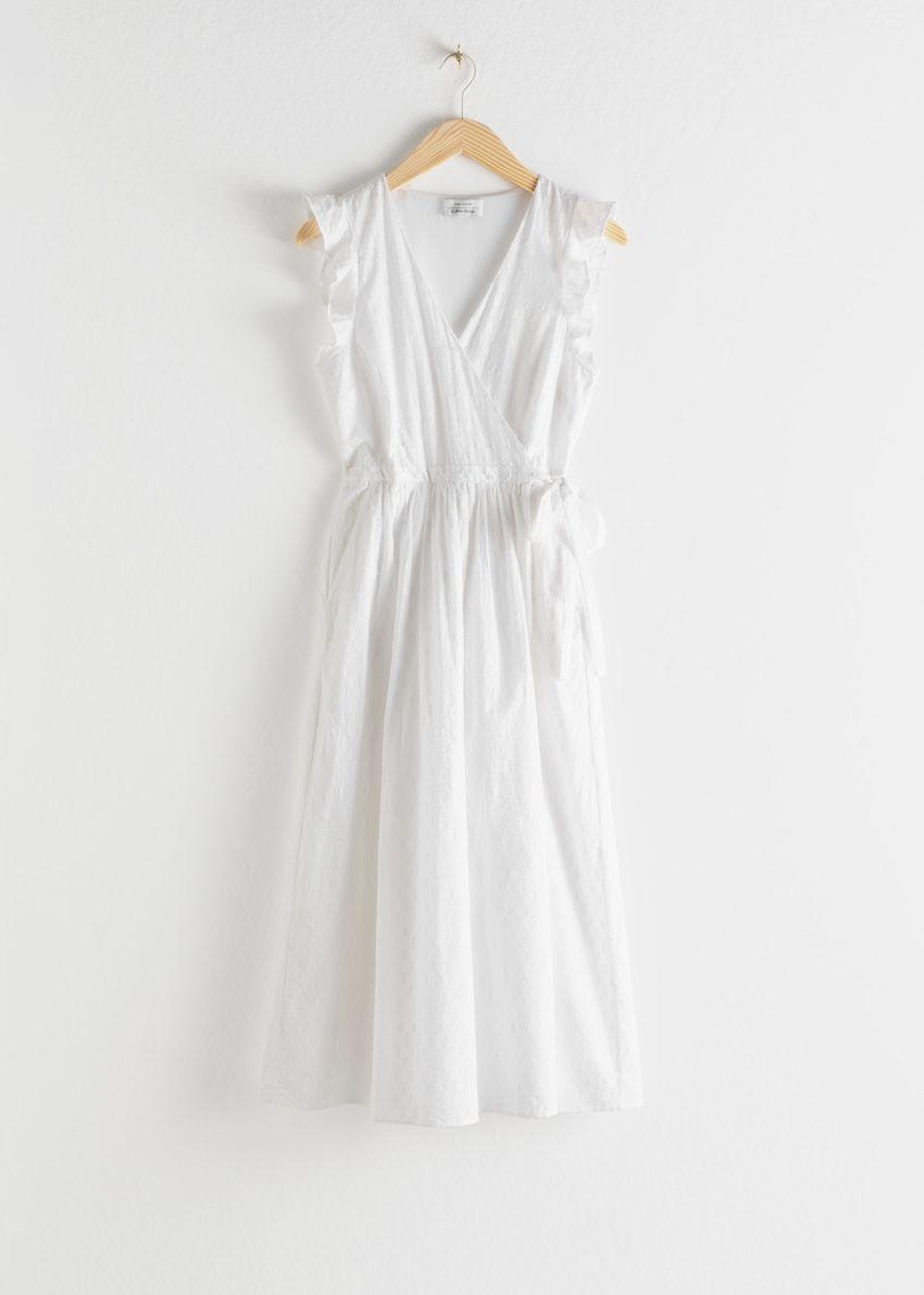 앤아더스토리즈 러플 미디 랩 드레스의 화이트컬러 Product입니다.