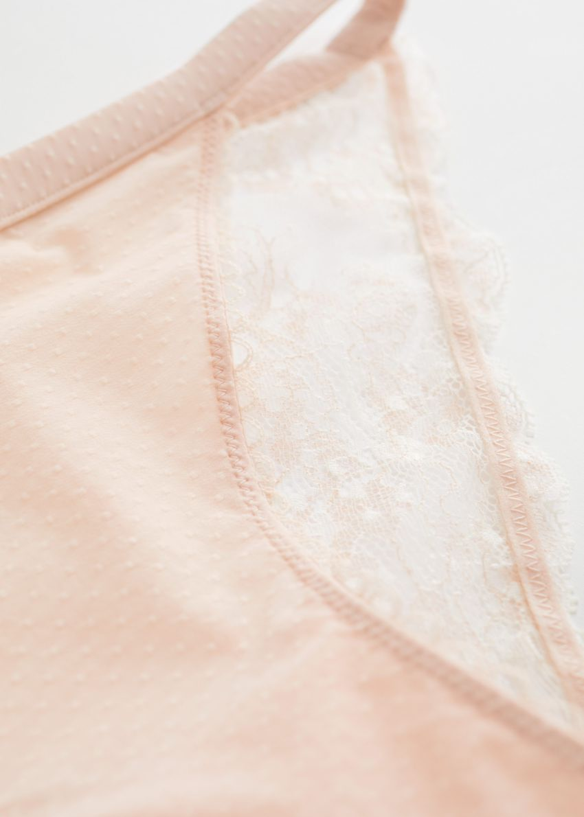 앤아더스토리즈 리나 미니 브리프의 오렌지컬러 Detail입니다.