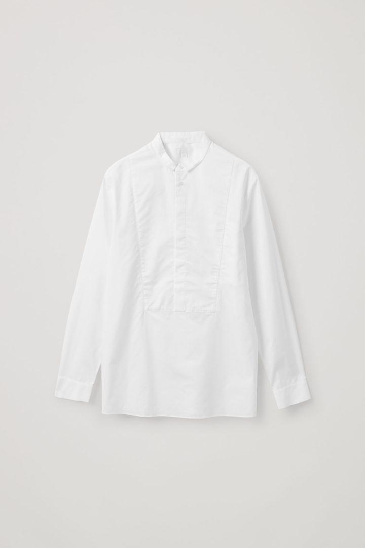 COS 코튼 튜닉 스타일 빕 셔츠의 화이트컬러 Product입니다.