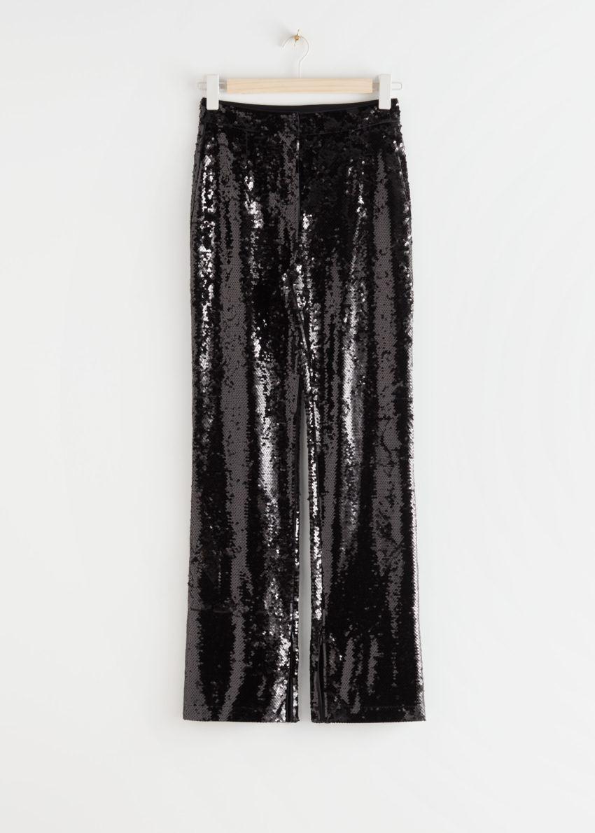 앤아더스토리즈 슬림 집 커프 시퀸 트라우저의 블랙컬러 Product입니다.