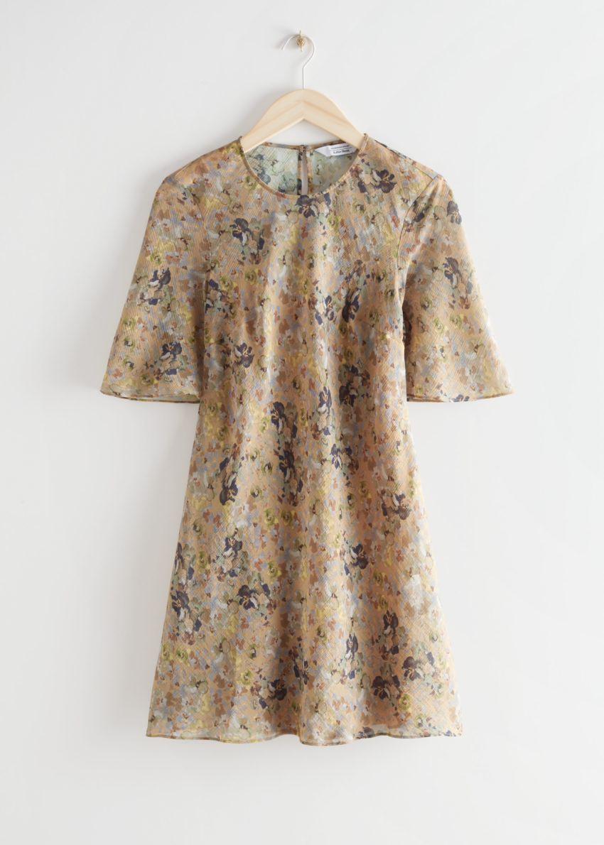 앤아더스토리즈 벨티드 A 라인 미니 드레스의 베이지 플로럴컬러 Product입니다.