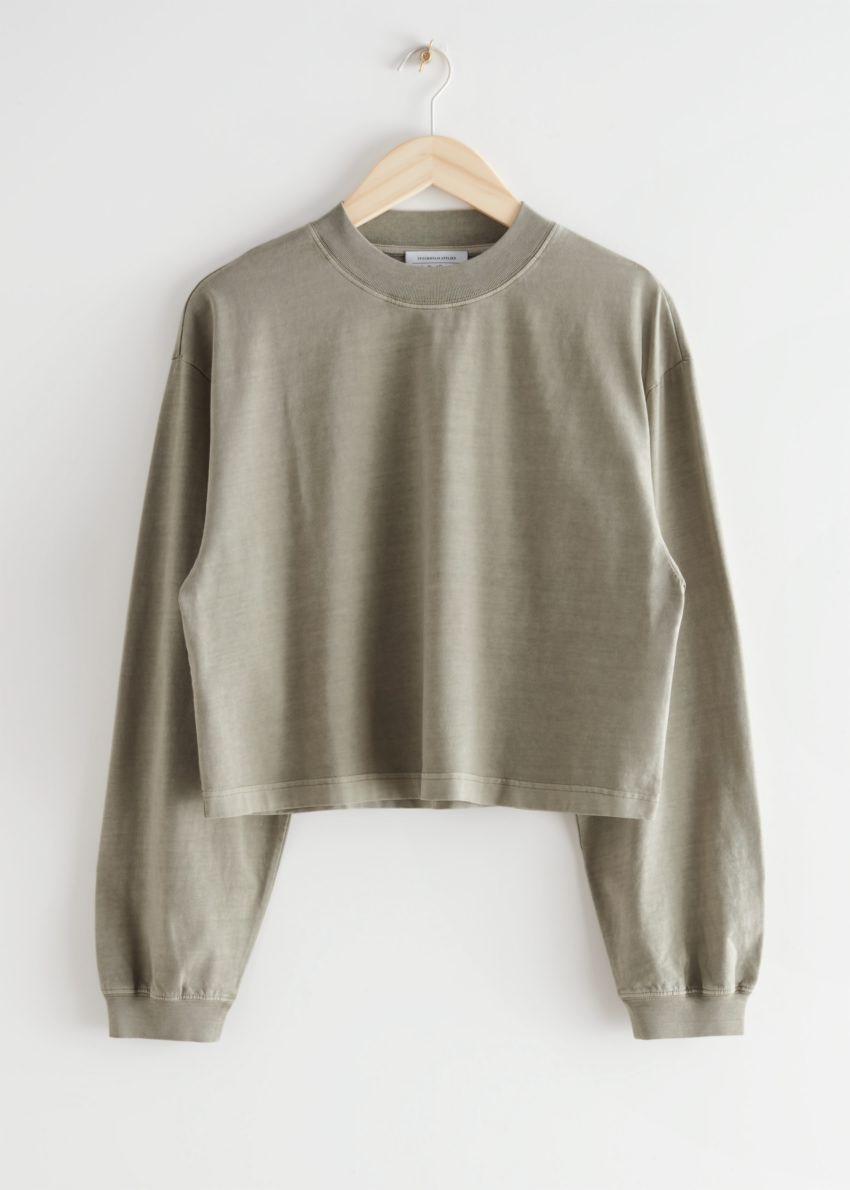 앤아더스토리즈 크롭 박시 코튼 스웨터의 베이지컬러 Product입니다.