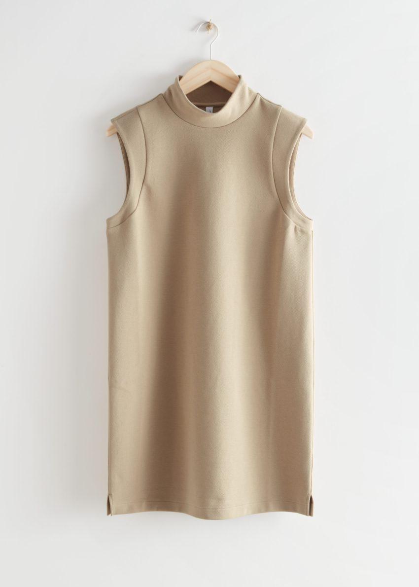 앤아더스토리즈 슬리브리스 모크 넥 미니 드레스의 베이지컬러 Product입니다.